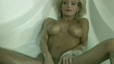 Blonde Milf in a bubble bath uses her vibrating toy to fuck herself