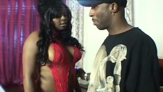 Ducky black whore in red lingerie shows off her nice ass and gives head