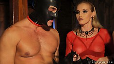 Mistress has her masked slaves perform for her as she watches
