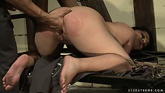 Her pink pussy lips are pried and pulled by her devious master