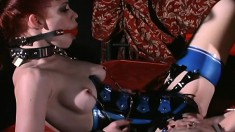 A gagged redhead slave gets her pussy eaten out by a dominant woman