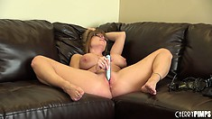 Darla Crane moans while rubbing a powerful vibe on her wet clit