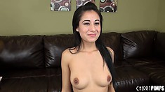 Skinny brunette Lilly Evans is interviewed and plays with her boobs
