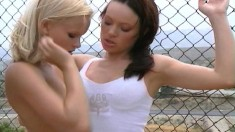 Two insatiable lesbian babes have a fuck fest in the hot sauna