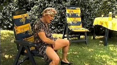 Horny old granny gobbles up his dick and gets drilled outside