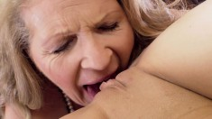 Luscious Granny Has A Striking Young Brunette Making Her Pussy Happy