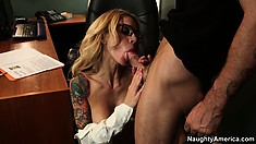 Naughty blonde office lady dominates a cock with her dainty feet