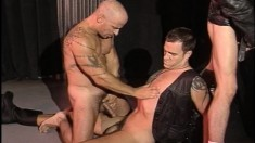 Inked stallion takes a throbbing jackhammer in his lusty gay mouth