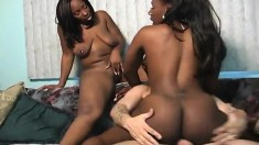 Two ebony gals give this white dude double the pleasure in a threesome