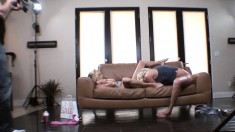 Two hot babes get it on on the couch while he watches and films them