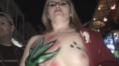 Watch these horny broads take their shirts of for the Mardi Gras event
