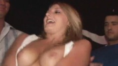 Slutty blonde chicks show off their perky tits in a wet T-shirt contest