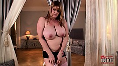 Chubby BBW with huge knockers poses and shows them off while stripping