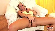 Sylvia Saint, a dazzling blonde with fabulous tits, loves to finger her snatch