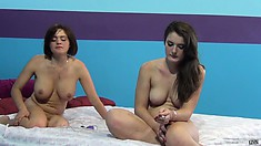 Krissy Lynn And Eden Young are on the bed waiting for their shoot
