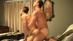 On all fours on the bed, he receives his buddy's stiff rod in his butt from behind