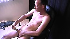 Slim twink clenches his pale butt-cheeks while jacking one off