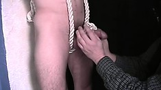 Cop gets jacked and is tied up nude as the dude plays with his cock