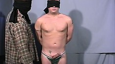 Hot dude with a blindfold gets a handjob and has his dick sucked