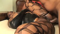 Kim Eternity strips off her latex and fucks him in her fishnets