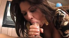 Sex-starved MILF gives into temptation and swallows a huge rod
