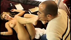 Buxom blonde milf plays with a dildo and pleases a cock with her feet