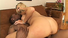 Hot blonde with splendid tits and ass has a black rod filling her twat