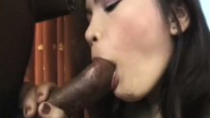Asian babe can't contain her excitement as she bounces on a dark dick