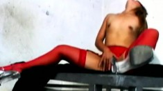 Blindfolded Asian girl in red stockings reveals her cock sucking skills