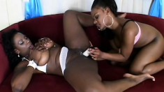 Black lesbians Kelly and Megan eat pussy and then toy fuck for an orgasm