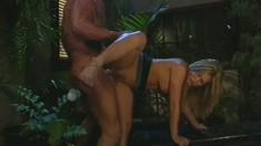 Avy Scott's big boobs sensually shake as she bounces on a long stick