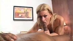 Insatiable blonde masseuse finds it hard to resist a huge black cock