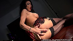 Busty babe in lingerie fingers her cunt and goes for her ass