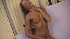 Sexy blonde shows hot posing and gets on the mat to rub her cunny