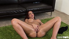Kelly spreads her hot body across the floor and gently plays with her juicy pussy