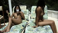 A couple of insatiable young girls can't wait to pose naked in the sun