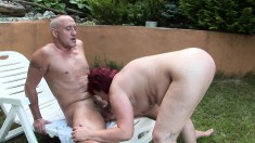 Red-haired granny wants to get her pussy plowed with a hard rod
