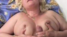 Chunky blonde broad squeezes her tits while riding a fat jackhammer