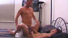 Older stud gives his young boyfriend a hard anal pounding on the bed