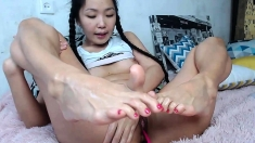 Asian Teen Nymph Having A Foot Fetish And Sucking Big Shaft