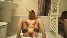 Desirable blonde mom Vanessa shows off her superb body in the bathroom