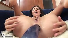 Brunette cutie, Monica B., uses a big anal dildo to stretch her ass